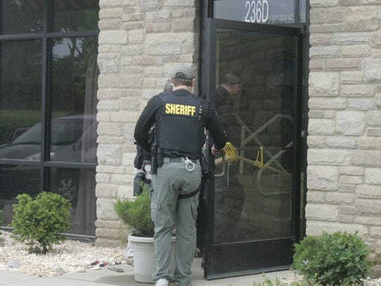 Deputies enter the H3O building after breaking the