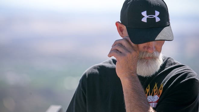 """Former Fuels Management Supervisor Todd Rhines wipes away tears as he tells the story of """"his boys,"""" the Granite Mountain Hotshots, near the summit of Thumb Butte in Prescott on Monday, June 30, 2014."""