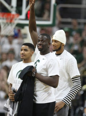 Former Michigan State players Draymond Green, Adreian Payne and Gary Harris  were introduced during second half action against Ohio State on Saturday, February 14, 2015, at the Breslin Student Events Center in East Lansing .