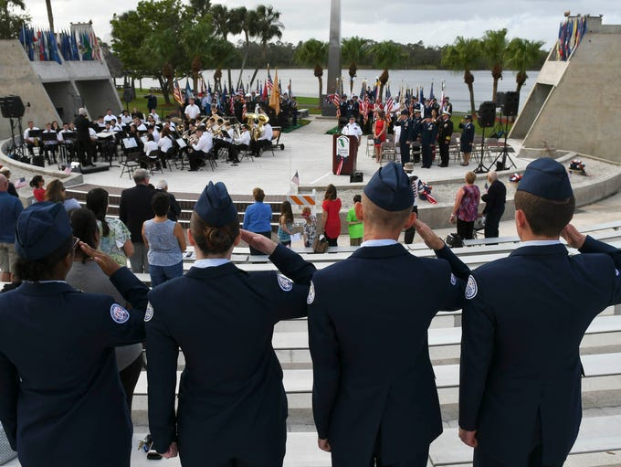 Four Air Force Jr. ROTC cadets salute during Saturday's