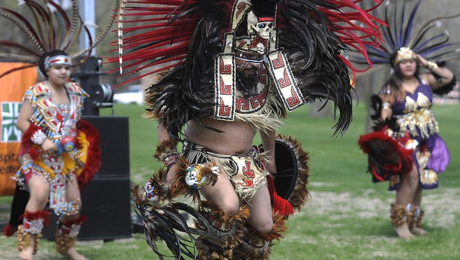 Emiliano Lira performs Mexica Yolotl, traditional Aztec dance, during Cinco de Mayo Fiesta at Falls Park in Sioux Falls, S.D., Saturday, May 11, 2013. (Emily Spartz/ Argus Leader)