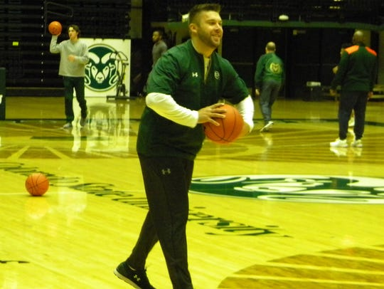 Jase Herl, CSU's interim men's basketball coach, passes