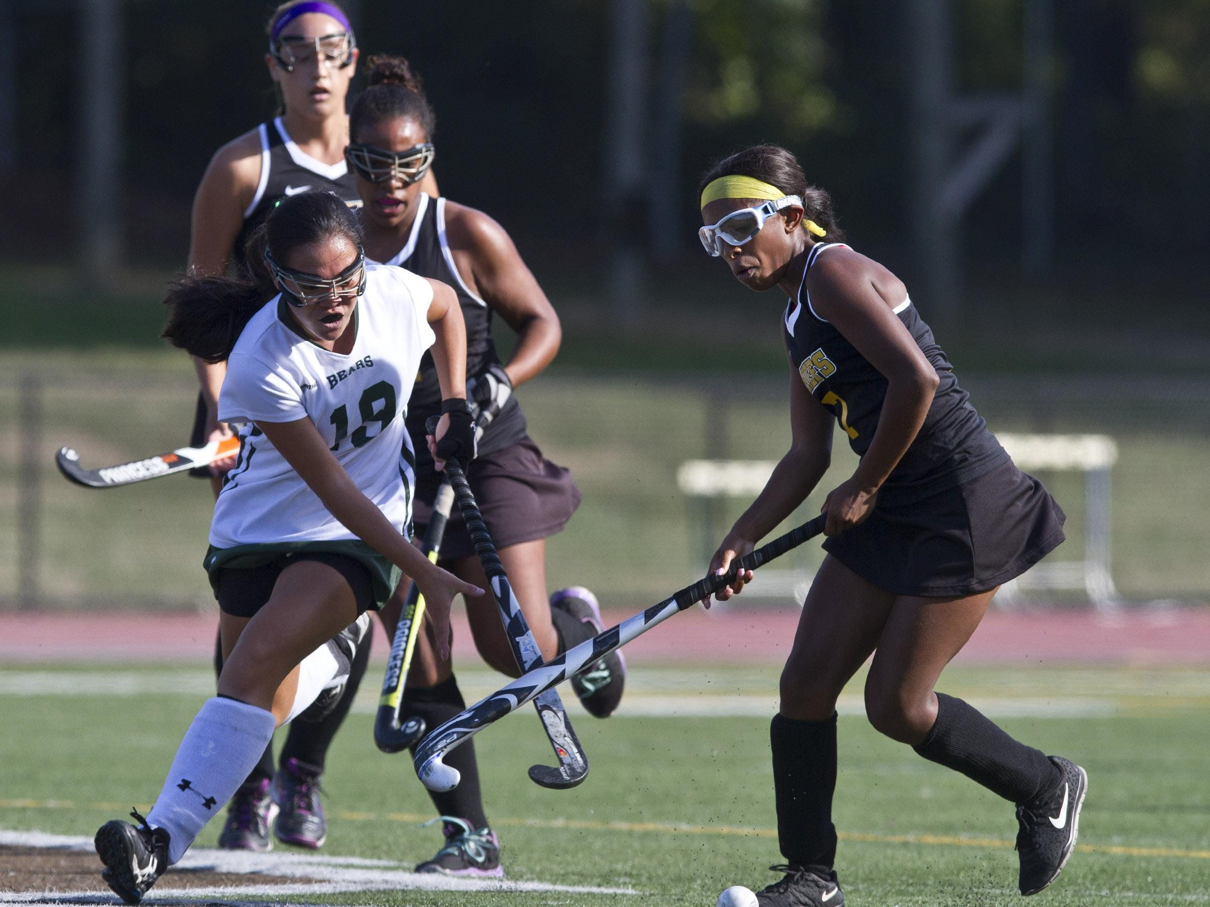 East Brunswick's Sydney Huang drives the ball past Piscataway's Dominique Nelson on Thursday.