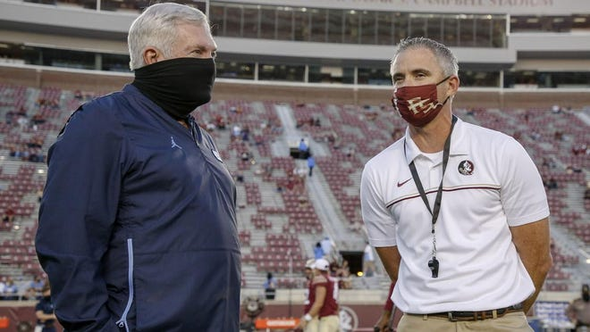 North Carolina coach Mack Brown, left, visits with Florida State coach Mike Norvell before the start of last weekend's game won by the Seminoles.