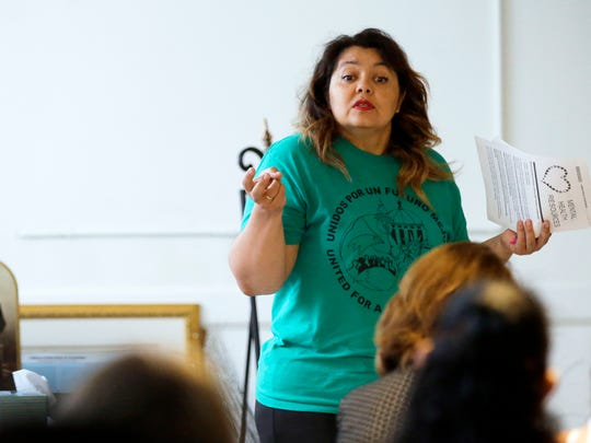 Norys Pina, a volunteer leader of Unidos Por Un Futuro Mejor (United for a Better Future), speaks about DACA on Sunday at St. Therese Parish in Appleton.