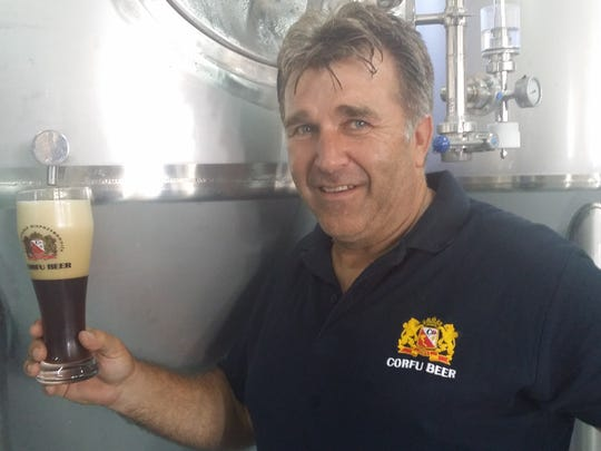 Spyros Kaloudis, owner of Corfu Beer, holds a glass