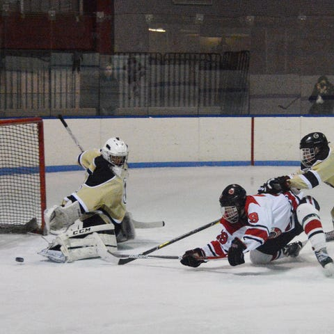 Clarkstown goalie Jason Inzeo redirects a shot...