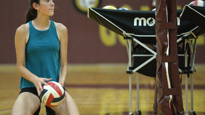 Freshman North East volleyball player Cadence Jones, 14, waits for her turn during a drill Monday at North East High School during the first day of official PIAA sports practices in the Erie region.