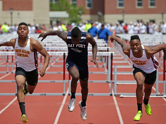 Kelvon Johnson of West Allis Central crosses the finish line ahead of Bay Port's Cordell Tinch, and Kelshawn Johnson of West Allis Central in the 110-meter hurdles.