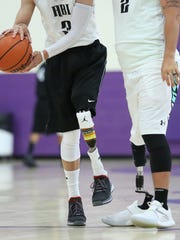 Devin Hinton, left, and Scott Odom play basketball on Saturday, 19, 2017, during Team Manny's Hoops for Hope fundraiser at Camino Real Middle School. During the event LCPD's basketball played against Amputee Basketball Invigorated
