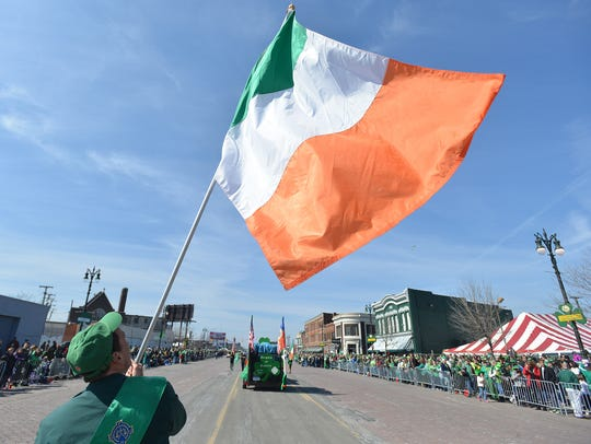 Erin Irwin waves an Irish flag while marching in the