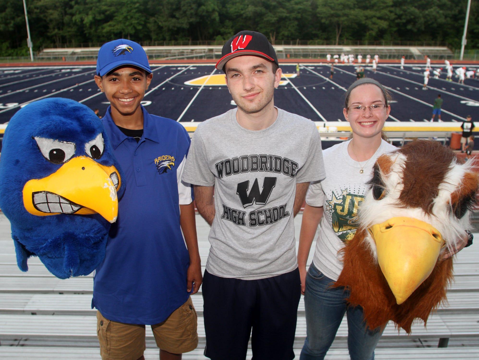 North Brunswick mascot Brian Jones, left, Woodbridge mascot Johnathon O'Halloran, center, and JP Stevens mascot Amanda Lombardi, Wednesday, at Colonia High School in Woodbridge, NJ.