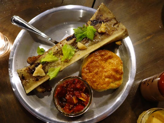 Bone marrow, oxtail, biscuits & pepper jam at Okra