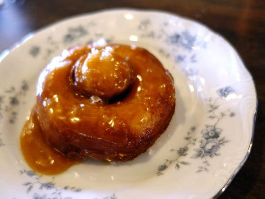 Canned biscuit doughnut with salted caramel at Okra
