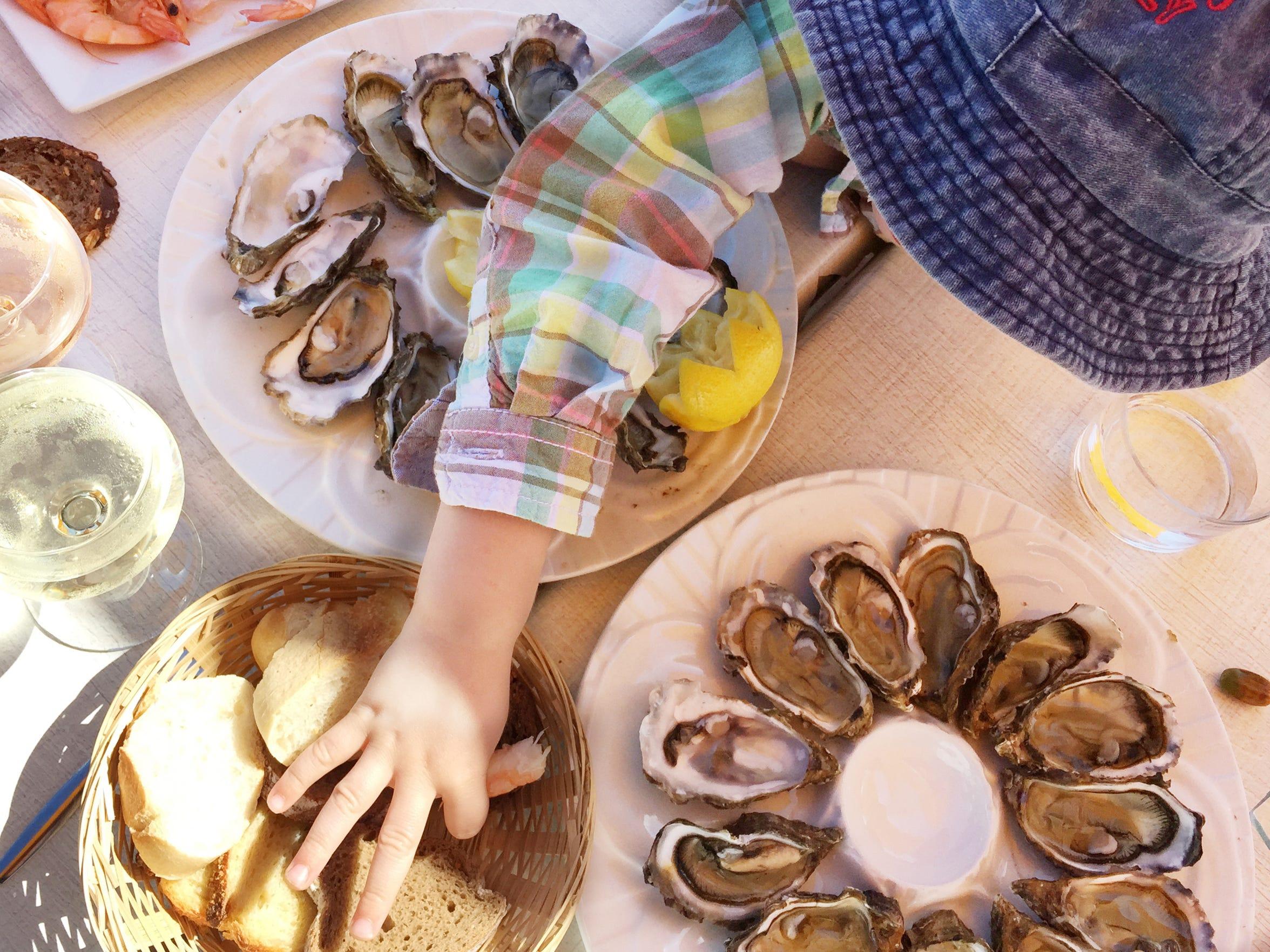 Walker Hughey enjoys an oyster lunch in Port de Larros,