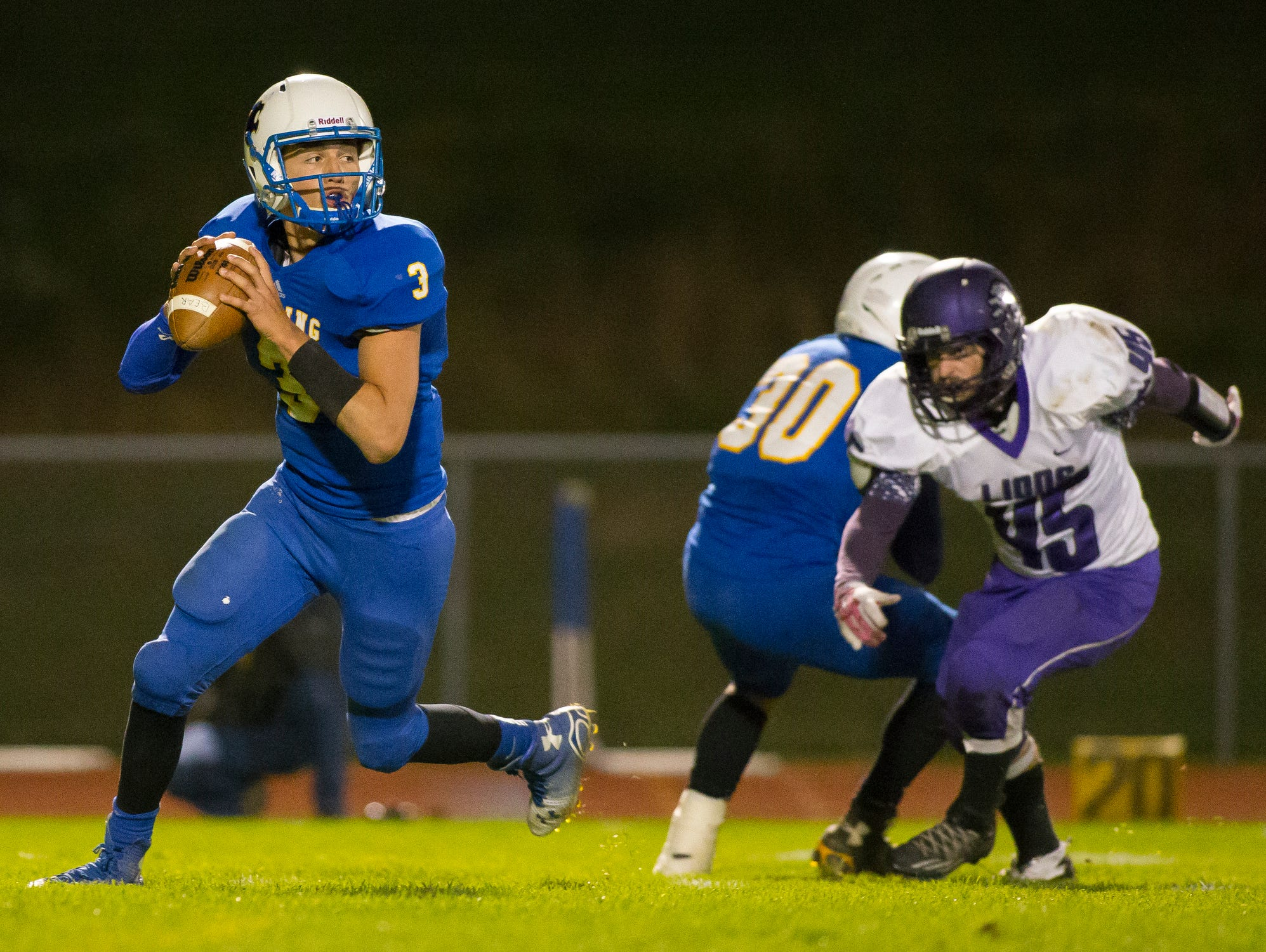 Lansing freshman quarterback Mason Boothe goes back to pass on Friday during the Bobcats' 18-13 defeat of visiting Dryden in a Section 4 Division V clash at Sobus Field. Boothe scored the Bobcats' third touchdown on a 1-yard run in the third quarter.