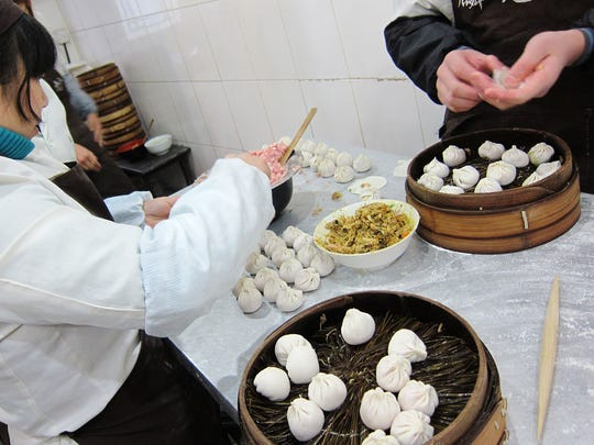 Employees at Lin Long Fang in Shanghai prepare xiao