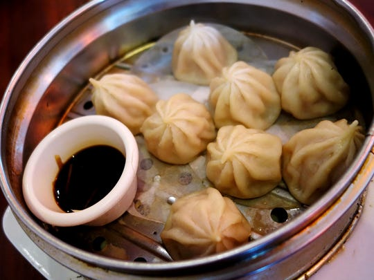 Beijing Garden's xiao long bao have thin wrappers and a lot of soup, but the flavor is flat.