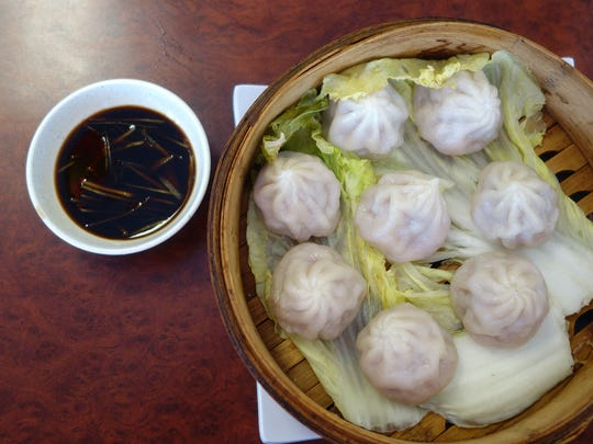 The xiao long bao at Dinghao Shanghai Bistro have a pretty good balance of construction and flavor. They'll do, until we have better.