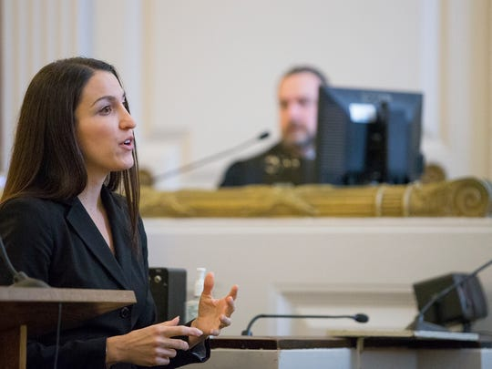 Assistant District Attorney Diane Lama gives the prosecution's opening argument in the trial of Benjamin Cayea Friday morning in Tompkins County Court. In the background is Judge Joseph Cassidy.