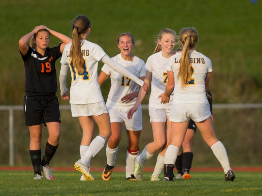 The Lansing girls soccer team celebrate scoring their third goal Tuesday evening during their Section 4 Class C semifinal against Marathon. The host Bobcats won, 5-1, and will play Elmira Notre Dame on Friday in Norwich for the sectional championship.