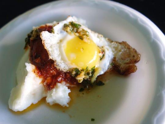 Mascarpone polenta with pork ragu, fried quail egg
