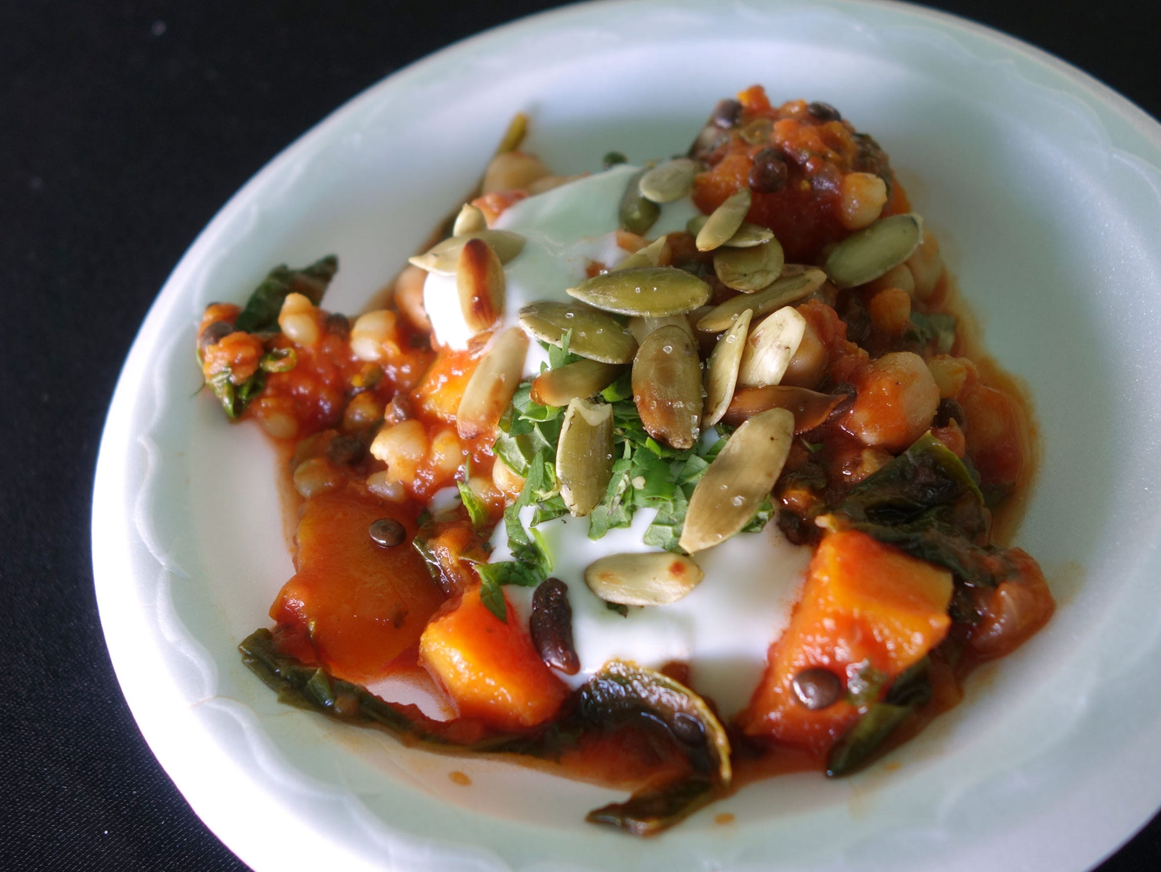 Moroccan-spiced chickpea and vegetable stew with lime yogurt and pepitas from Rancho Pinot.