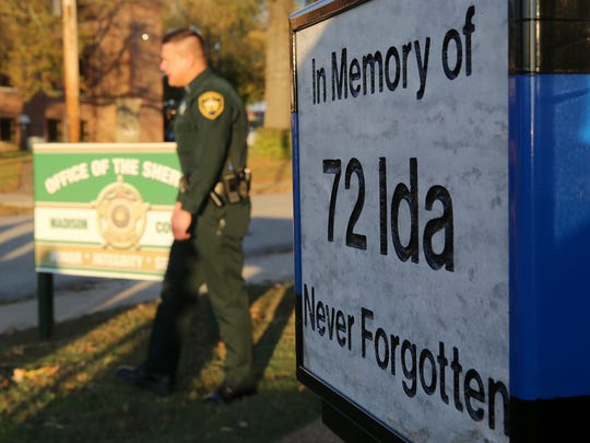 A memorial for Deputy Rosemary Vela is seen at the Madison County Sheriff's Office on Monday afternoon.