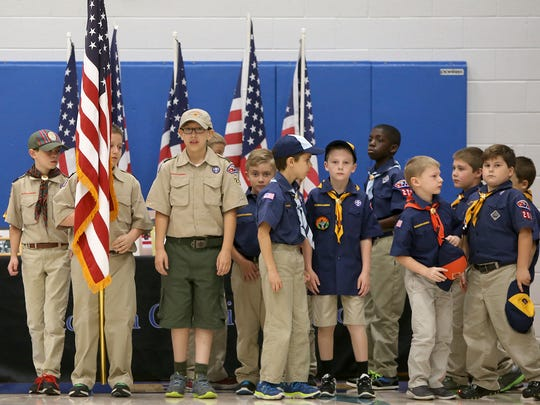 Boy Scouts and Cub Scouts from the West Tennessee Area Council prepare to present the colors during Jackson Christian's Veterans Day celebration in their main gymnasium, on Wednesday, Nov. 11, 2015.