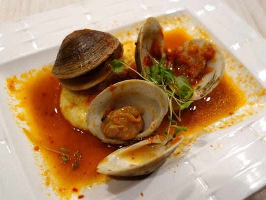 The second course: Clams with lobster bottarga from