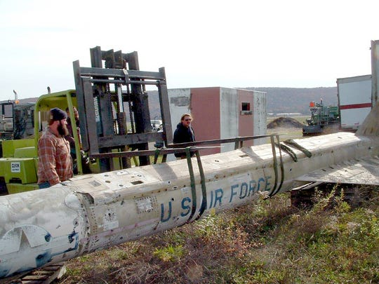 A GAM-77 (Hound Dog) Cruise Missile is lifted from