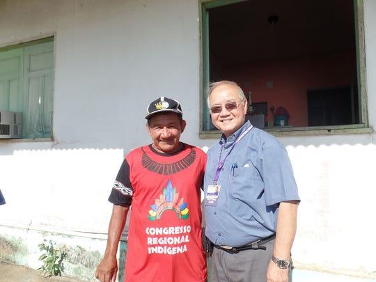 "Paul Yeun in the Amazon with a gentleman Yuen identifies as a ""Multitinga tribal chief."""