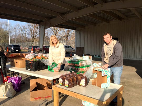 Laurie Heffelfinger and Ryan Steelman work food distribution at York Benevolent Association after successful food drive.