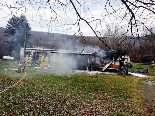 Smoke billows from a State Route 53 home in Wheeler