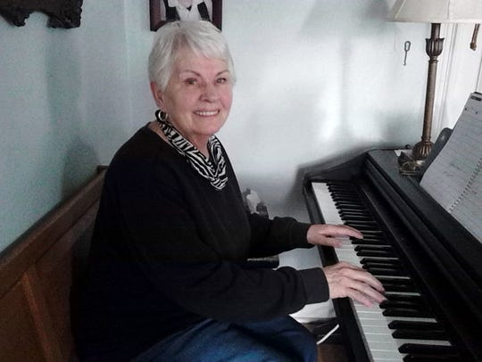 Singer Jeanette Beck at the piano in her Lebanon home