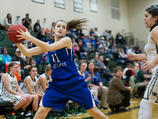 Fort Defiance's Erin Henderson saves a ball from going