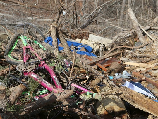 A mangled bicycle sits among the tornado damage next