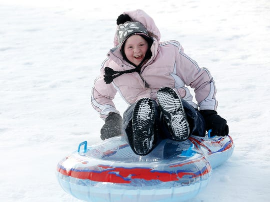 Kids, teens and families took to the hill at Buttermilk Creek Park for some winter fun.