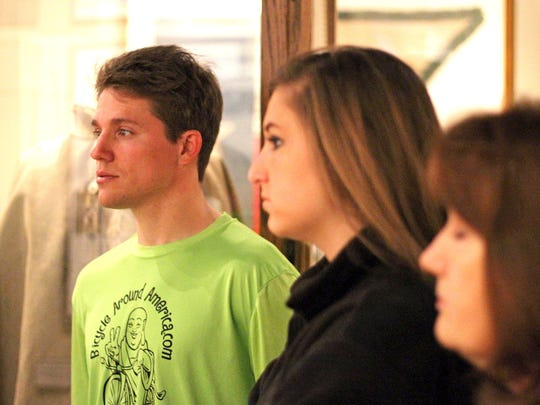 Brian D'Apice stands next to his cousin, Michelle Krutza, and his aunt Marti Krutza during a presentation at the American Freedom Museum in Bullard, Texas. D'Apice is currently bicycling around America to raise money for military families and education.