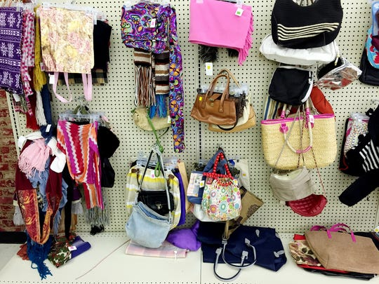 Hand purses and bags hang on the walls at the new Salvation Army Thrift store in Madison.