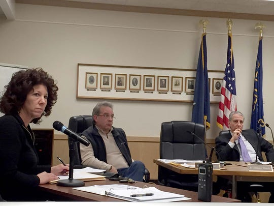Lebanon Mayor Sherry Capello and city councilmen, from left, Richard Wertz and Wiley Parker listen to disgruntled property owners voice their displeasure about the proposed Business Improvement District at Thursday's council workshop meeting.