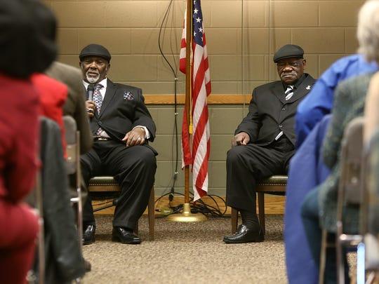 Baxter Leach, left, along with Alvin Turner, address