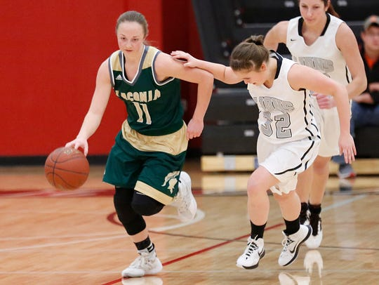 Laconia's Caitlyn Tipton (left) is the Spartans' leading