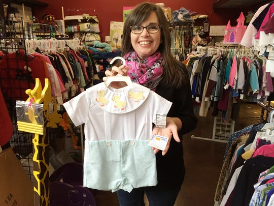 Michelle Hicks shows off a little boy outfit at Childrens Trove Consignment. The boutique price was $54, and in this store it is tagged for $30.
