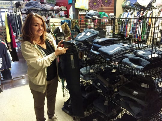 Sherri Clifton, owner of Childrens Trove Consignment, shows the jean area of the teen department, where most jeans are under $30.