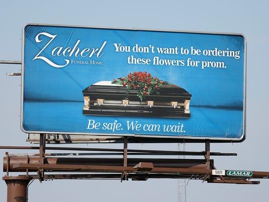 635931229113537346-FON-casket-billboard-030616.jpg