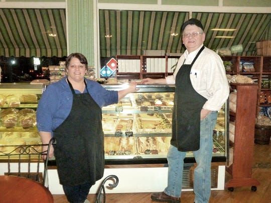 Judy Martin and Doug Maguire in front of pastry case.