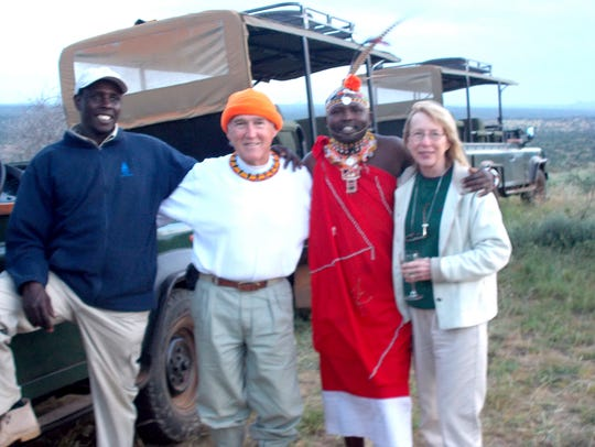 "Safari guide Roger, Bruce Kreider, ""Chief"" and Kathy"