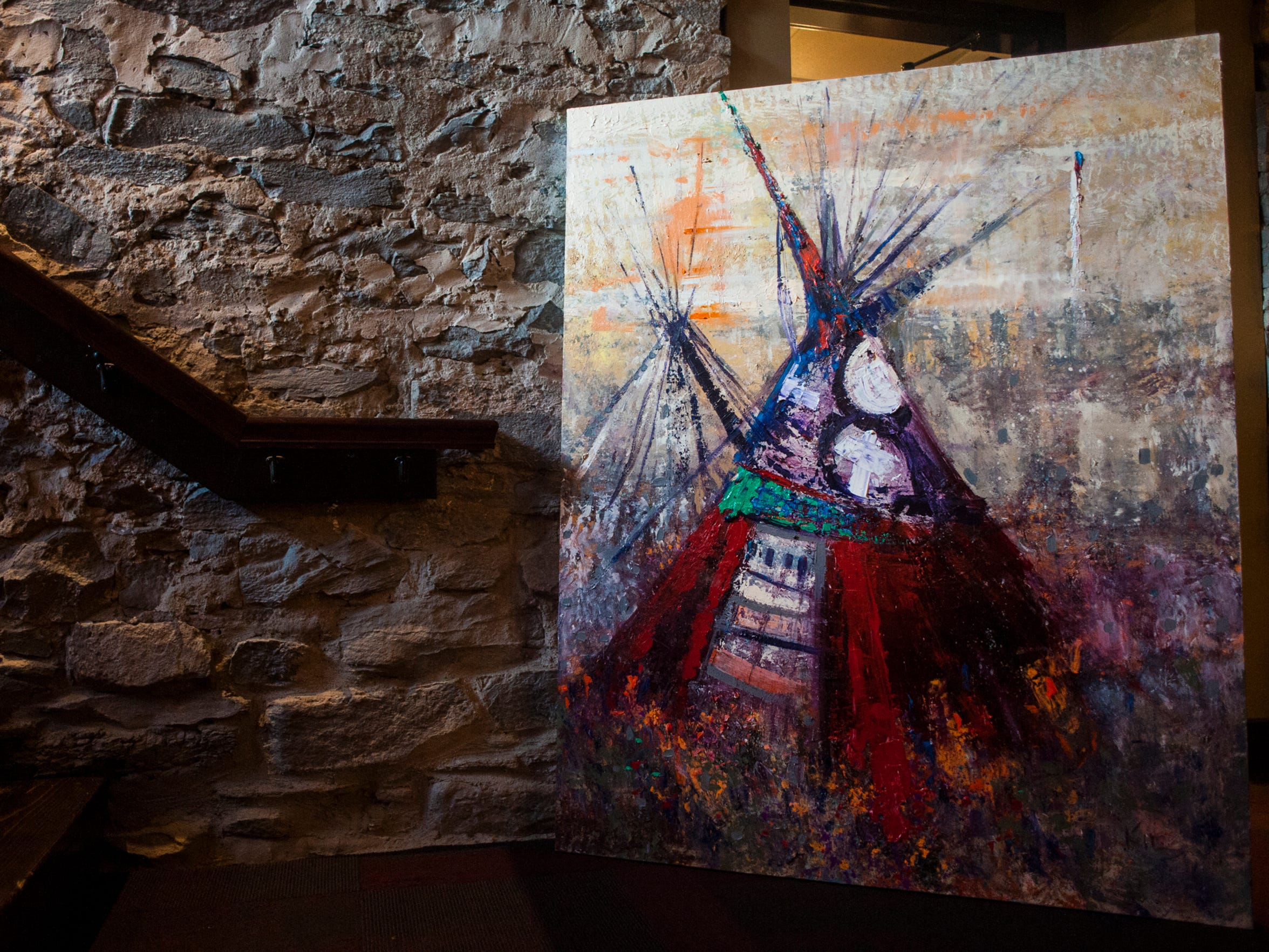 Kira Fercho's paintings can be seen downstairs at the Celtic Cowboy. They were photographed Thursday, March 17, 2016.