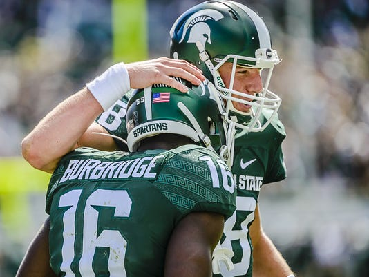 Connor Cook and Aaron Burbridge